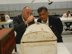 Dr. Surin listening to Dr. Tarek's explanation about Tutankhamun's collection Wood Box in the Wood lab.